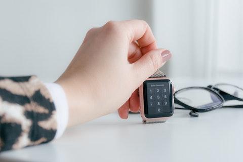 girl holding a smart watch