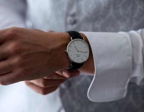 man putting on a watch