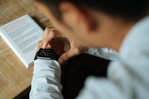 man using a digital watch