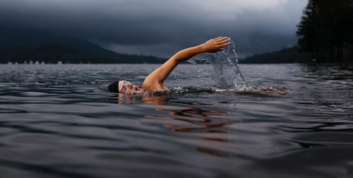 Cold lake swim in the dark evening